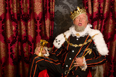 Slaperige gedronken koning Stock Foto's