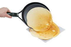 Slapjack lie on frying pan. Isolated on white Stock Photography