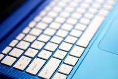 slapp ton för blå bildtangentbordanteckningsbok Royaltyfri Foto