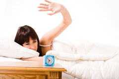 Slapping the annoying alarmclock Royalty Free Stock Photography