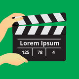 Slapstick movie. Movie clapper in female hands on a green background Stock Image