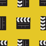 Slapstick movie. Seamless pattern firecrackers for the movie on a yellow background Royalty Free Stock Images