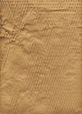 Slashed paper. Slashed brown wrapping paper texture as a background royalty free stock image