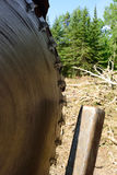 Slasher Circular Saw on Log Landing Royalty Free Stock Photos