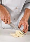 Slashing cheese Royalty Free Stock Images