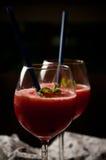 Slaskig drink för röd melon fotografering för bildbyråer
