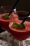 Slaskig drink för röd melon arkivbilder