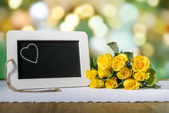 Slate blackboard heart and roses Stock Images