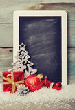 Slate board with Christmas decoration Royalty Free Stock Photography