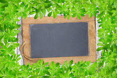 Slate board framed with woodruff Stock Photography