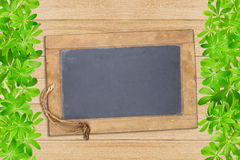Slate board framed with woodruff Royalty Free Stock Photo
