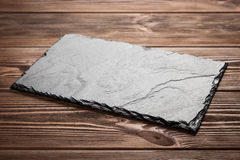Slate board on wood Stock Images