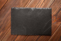 Slate board on wood Royalty Free Stock Photography