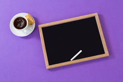 Slate and chalk with black coffee. On purple background Royalty Free Stock Photo
