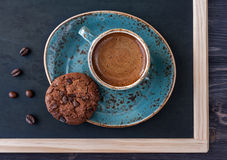 Slate chalk board with a cup of coffee and chocolate chip cookies. Vintage style Stock Photography
