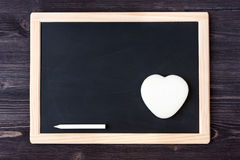 Slate chalk board on wooden background Stock Photo
