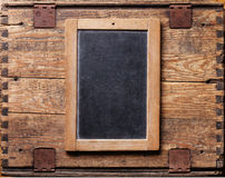 Slate chalk board on wooden background Stock Images