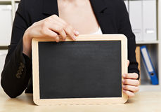 Slate chalkboard in office Royalty Free Stock Photography