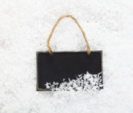 Slate chalkboard in snow Royalty Free Stock Photography