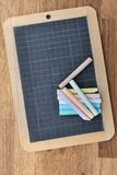 Slate and chalks Royalty Free Stock Photos