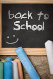 Slate with colorful crayon, back to school Royalty Free Stock Image
