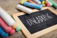 Slate with colorful crayon, concept invitation Stock Photos