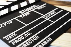 Slate for cut film placed on wooden floor. Slate for cut film placed on wooden floor stock photography