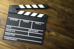 Slate for cut film placed on wooden floor. Slate for cut film placed on wooden floor royalty free stock photography