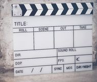 The slate film is used to film the movie on the cement floor. The slate film is used to film the movie on the cement floor stock photo