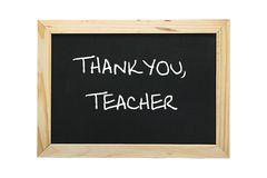 Slate with grateful message to teacher. Image of a black slate with grateful message to teacher. Isolated on white background. Clipping path included royalty free stock photography