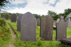 Slate Grave Stones, dark blue grey stone. Royalty Free Stock Photography
