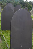 Slate Grave Stones, dark blue grey stone. Stock Photography