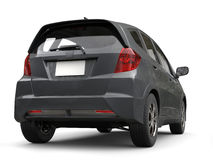 Slate gray metallic modern compact car - back view Stock Images