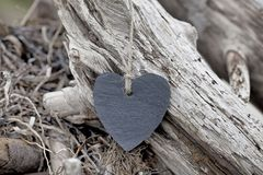 Slate Heart And Driftwood stock photo