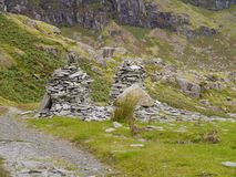 Slate installations by quarry area. Remnants of a slate building by a quarry now appearing as some installation art stock images
