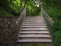 Slate ladder with guardrail. Slate ladder with iron guardrail in the park Royalty Free Stock Photos