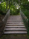 Slate ladder with guardrail. Slate ladder with iron guardrail in the park Stock Photos