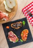 Slate plate with bruschettas Royalty Free Stock Image