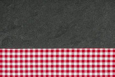 Slate plate with a checkered tablecloth Royalty Free Stock Photography