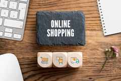 Slate plate with message `online shopping ` and cubes with related icons royalty free stock image