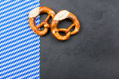 Slate plate with pretzels with a bavarian diamond pattern Royalty Free Stock Images