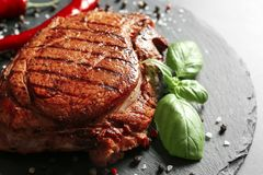 Slate plate with tasty grilled steak, closeup royalty free stock image