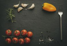 Slate plate with tomatoes and spices stock photo