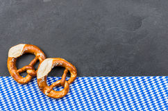 Slate plate with two pretzels with a diamond pattern Royalty Free Stock Photos