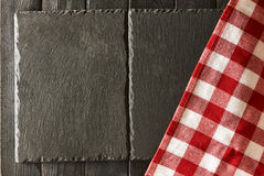 Slate plates and tablecloth Royalty Free Stock Image