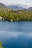 Slate quarry lake with Snowdon Stock Images