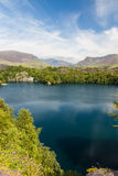 Slate quarry lake with Snowdon Royalty Free Stock Image