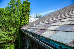 Slate Roof. And copper eavestrough on old house royalty free stock photo