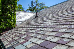 Slate Roof. And copper eavestrough on old house royalty free stock photos