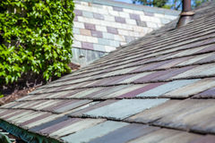 Slate Roof. And copper eavestrough on old house stock photography
